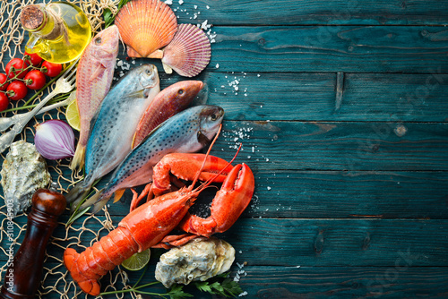 Fototapeta Seafood on stone background. Lobster, fish, shellfish. Top view. Free copy space. obraz