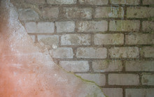 Texture Of Old White Brick Wall With Remnants Of Plaster