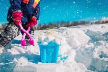Child Making Snowballs In Wint...