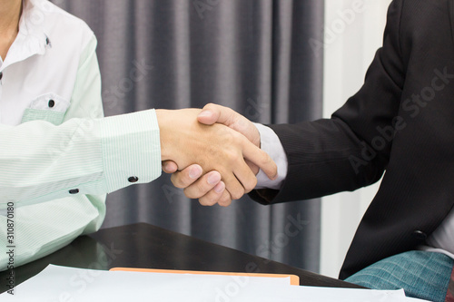 Fototapety, obrazy: business man shaking hands during a meeting in the office, success, dealing, greeting and partner concept.