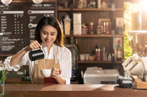 Female barista making coffee Canvas Print