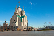 An Unusual Orthodox Church Under Construction Against A Blue Sky. In The Background You Can See The Ferris Wheel.