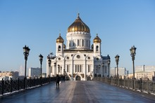 Cathedral Of Christ The Savior Surrounded By Buildings And Lamps Under A Blue Sky