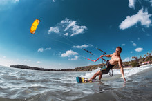 Real Wakeboarder With Kite At Sea Bay