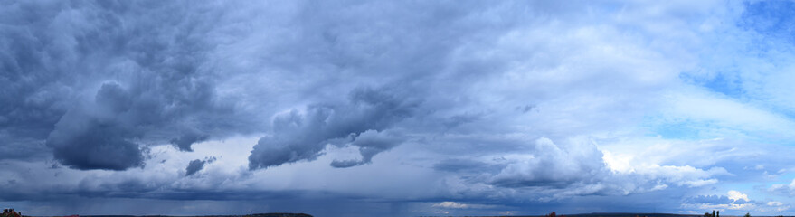 Cloudy sky. Autumn atmospheric phenomenon, panoramic photography, mid-September.