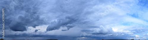 Obraz Cloudy sky. Autumn atmospheric phenomenon, panoramic photography, mid-September. - fototapety do salonu