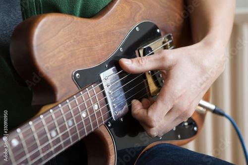 Man Strums Chord On Guitar Slika na platnu
