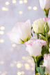 canvas print picture Eustoma flowers near bokeh on light background. Blank for postcards