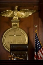 Judge's Seat; Bird; Gavel And American Flag In Court