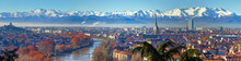 Aerial Panoramic Winter View On Turin City Center With Mole Antonelliana, Modern Skyscrapers And Other Buildings, Clear Blue Sky Morning With Alps Full Of Snow On Background