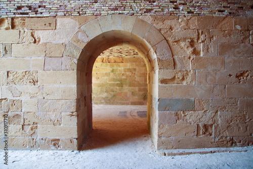 Wallpaper Mural old door in stone wall