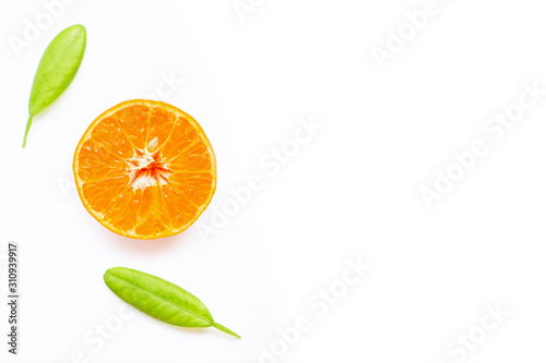 Fresh orange citrus fruit with leaves on white background.