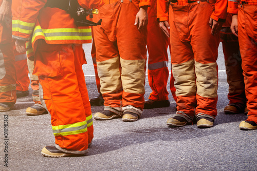 Fire fighter officers preparing to rescue, line of uniform for protection from f Wallpaper Mural