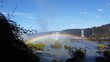 Iguazu falls with rainbow on the nearest point where the people can go.