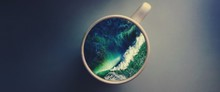 White Cup With Water. Sea. Ocean. Sea Waves. Creative Postcard.