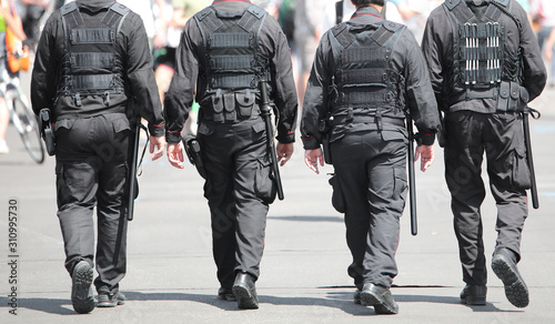 Cuadros en Lienzo Four cops with uniform