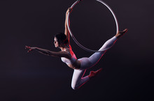 Young Woman Performing Acrobat...
