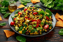 Mexican Salad With Avocado, Black Beans, Sweet Corn, Spinach, Tomatoes And Tortilla Chips