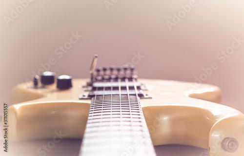 Photo Electric guitar stratocaster sunburst closeup, macro abstract