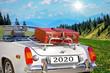 canvas print picture - Reisen und Urlaub im Jahr 2020 - Mit dem Cabrio in den Bergen