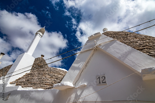 Photo  Number 12 post street plate, twelve and roofs of truli, typical whitewashed cyli