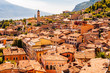 Limone Sul Garda cityscape on the shore of Garda lake surrounded by scenic Northern Italian nature. Amazing Italian cities of Lombardy