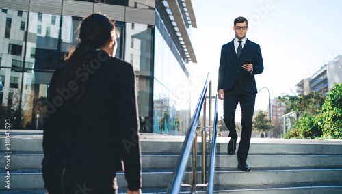 Contemporary business people on street stairway Back view of modern businessman Canvas Print