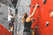 Sportswoman Climber Moving Up ...