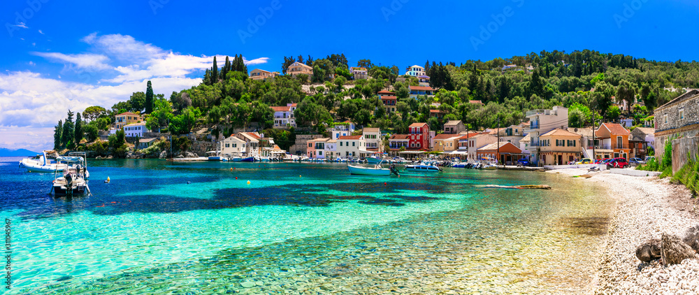 Fototapeta Authentic tranquil Paxos island. Loggos fishing village. Ionian islands of Greece