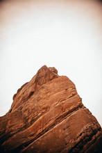 Big Red Rock With White Sky