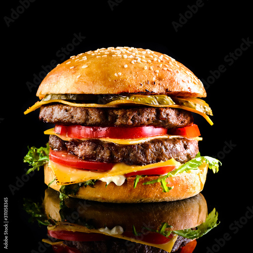 Homemade double cheese burger Black background