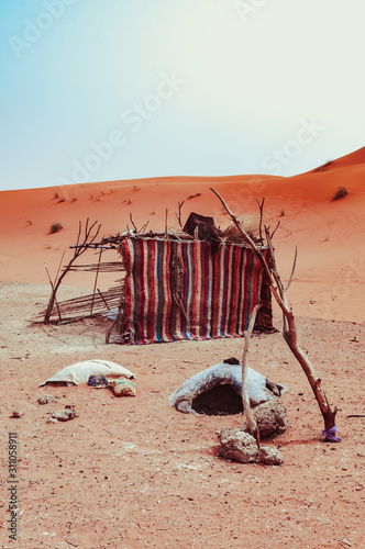 Photo Life of Moroccan bedouins in sahara desert, traditional moroccan oven and tent i