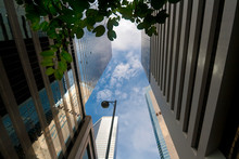 Up View To Scyscrapers In Hong Kong, Wan Chai District, Business Downtown In A Sunny Day