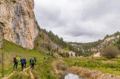 Hikers in a karstic landscape