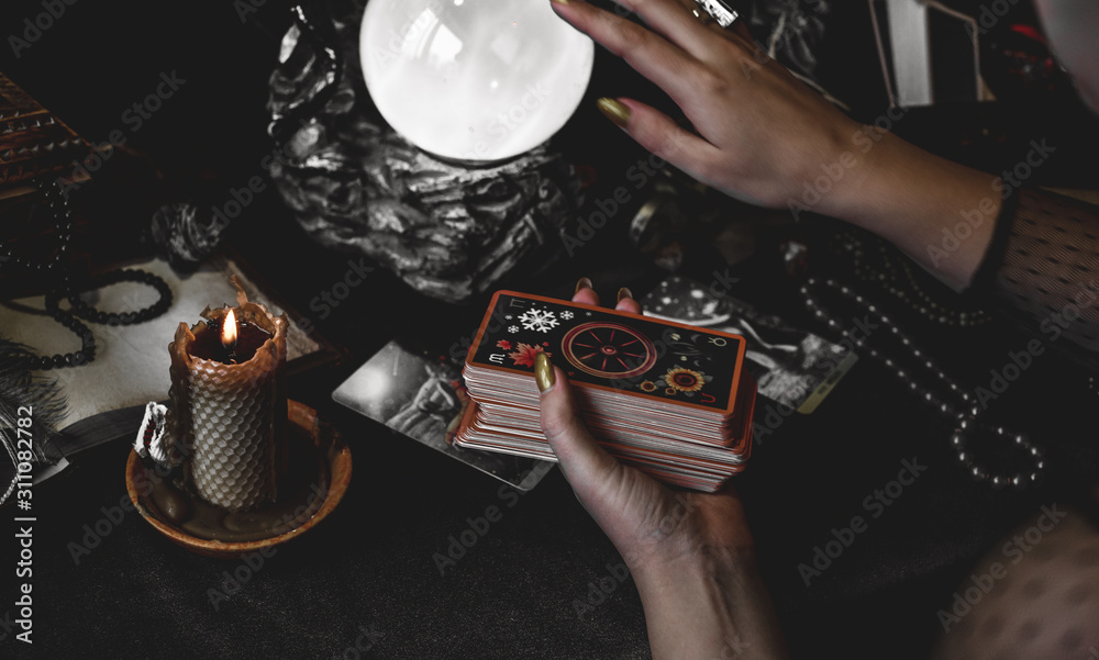 Fototapeta Magical scene, esoteric concept, fortune telling, tarot cards on a table