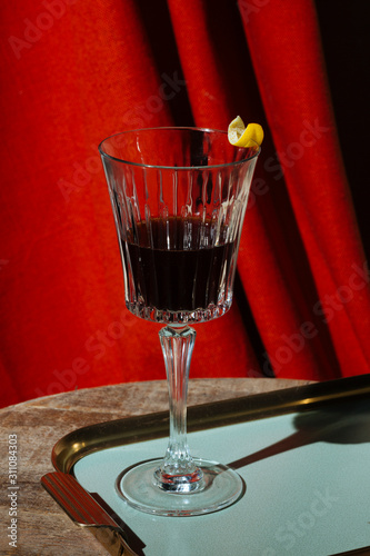 Red vermut (or vermouth), a fortified wine, garnished with lemon peel, in Venice Wallpaper Mural