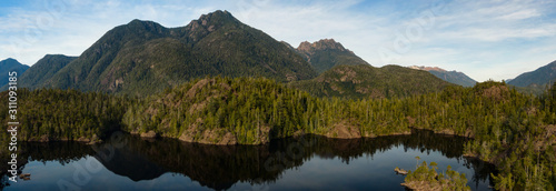 Beautiful Aerial Panoramic View of Larry Lake during a vibrant sunny day. Located on the West Coast of Vancouver Island near Tofino and Ucluelet, British Columbia, Canada. #311093185