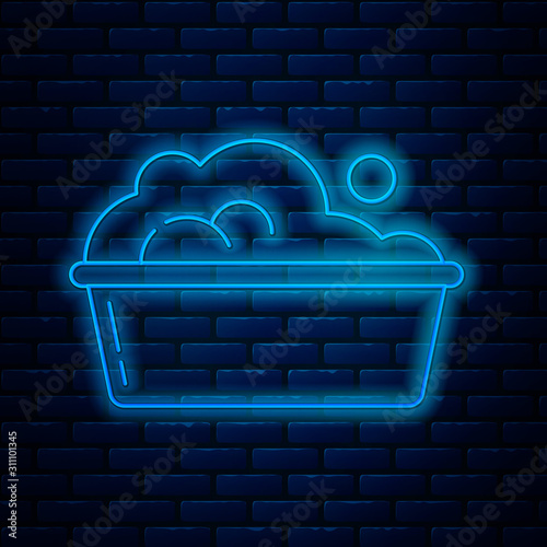 Fotomural  Glowing neon line Plastic basin with soap suds icon isolated on brick wall background