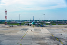 Backside Image Of Airliner Parking At  The International Airport