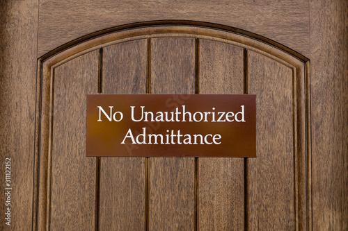 No Unauthorized Admittance, brown sign on a wooden door, sign to indicate that e Canvas Print