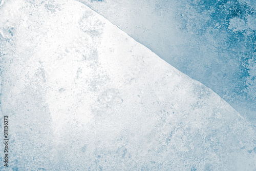 Obraz Ice texture background. Textured frosty surface of cracked ice block against white. - fototapety do salonu