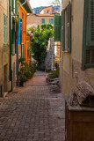 Fototapeta Uliczki - Villefranche-sur-Mer, France, October 10, 2019. Typical urban view. Picturesque narrow street in the old town