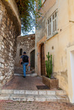 Fototapeta Uliczki - Villefranche-sur-Mer, France, October 10, 2019. Typical urban view. Picturesque narrow street with stone steps in the old town