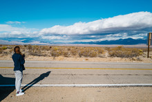 A Stylish Young Woman On A Road Trip In The Mojave Desert
