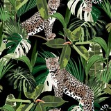 Cheetah and leopards palm leaves tropical watercolor style in the jungle seamless vector background. Black backdrop.