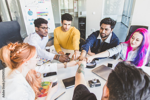 Fototapety, obrazy: Group of multi ethnic executives discussing during a meeting. Business man and woman sitting around table at office and smiling. A team of young creative designers