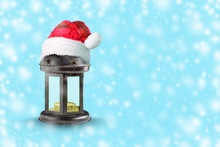 Christmas Lantern In The Hat Of Santa Claus On A Blue Background. Copy Space. New Year. Christmas Background.