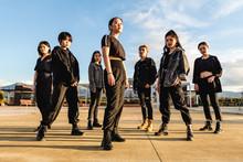 Young Asian Team Posing Lookin...