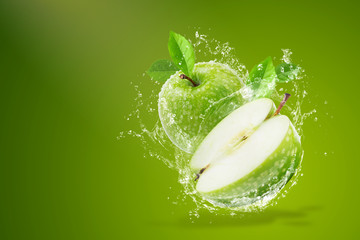 Water splashing on Fresh green apple on Green background