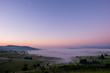 Sunrise on the mountain with morning fog in the valley.